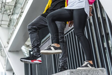 cropped image of stylish young couple dancing at urban street