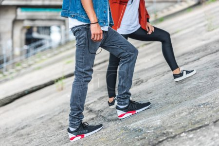 cropped image of stylish young couple standing at city street