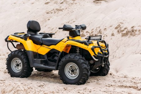 modern yellow all-terrain vehicle on sand