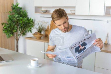 man reading newspaper during morning