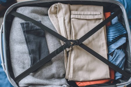 Photo for Elevated view of clothes in traveler suitcase - Royalty Free Image