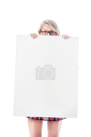 obscured view of blond woman in eyeglasses holding blank banner isolated on white