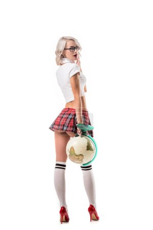 sexy blond woman in eyeglasses and college uniform holding globe isolated on white