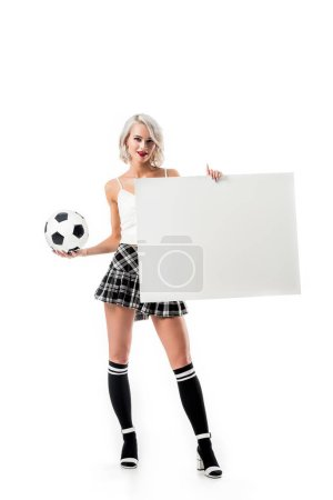 sexy blond woman in short plaid skirt with football ball and empty banner posing isolated on white