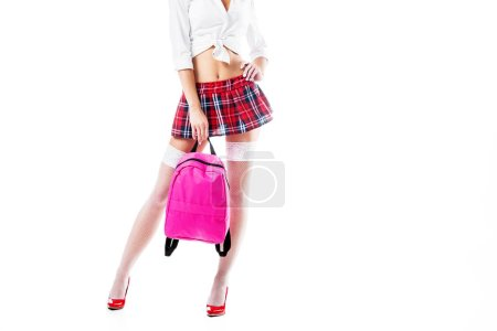cropped shot of seductive woman in short schoolgirl skirt ad stockings with backpack isolated on white