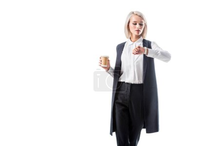 portrait of businesswoman in formal wear with coffee to go in hand checking time isolated on white