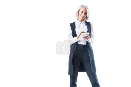 Photo for Smiling businesswoman with notebook looking at camera isolated on white - Royalty Free Image
