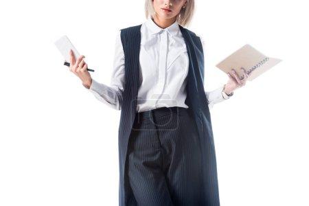 Photo pour Plan recadré de femme d'affaires avec smartphone et ordinateur portable dans les mains isolées sur blanc - image libre de droit
