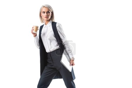 young businesswoman with coffee to go and laptop isolated on white