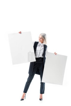 young businesswoman holding empty banners isolated on white