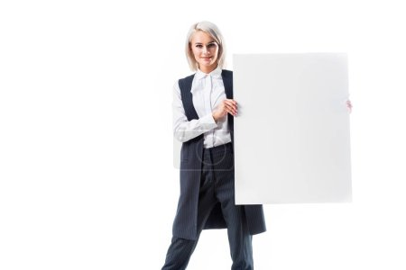 Photo for Smiling businesswoman showing empty banner isolated on white - Royalty Free Image