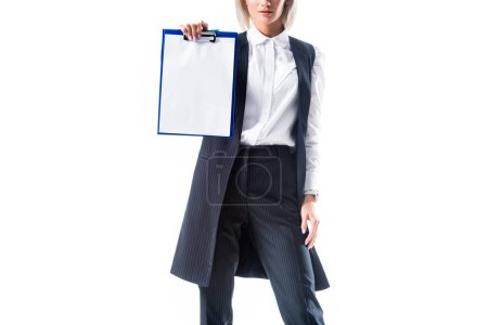 cropped shot of businesswoman in formal wear showing empty notepad isolated on white