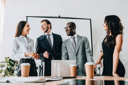 Photo for Smiling multicultural business people having business meeting in office - Royalty Free Image