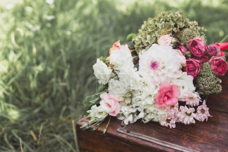 close-up view of beautiful wedding bouquet of vintage wooden chest outdoors