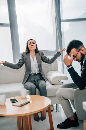 depressed patient crying and gesturing in psychologist office