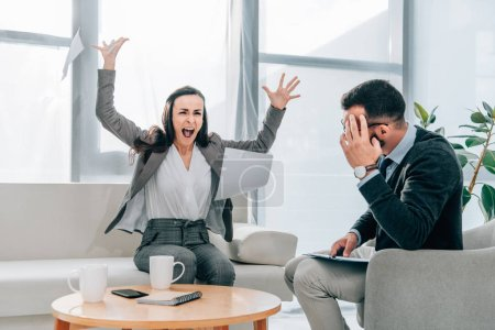 angry patient throwing papers in psychologist office