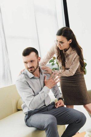 psychiatrist talking to depressed male patient in office