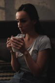 sad emotional woman holding cup of coffee