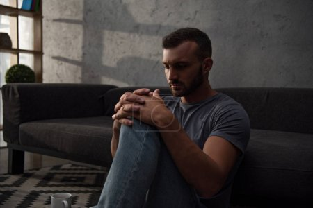 lonely depressed man sitting at home