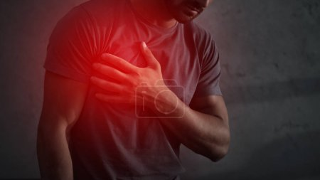 cropped view of man having heart attack with red painful point