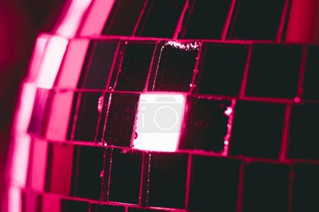 close-up view of shiny pink glittering disco ball, party background
