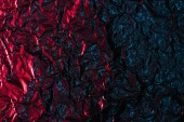 glittering abstract crumpled red and black foil background