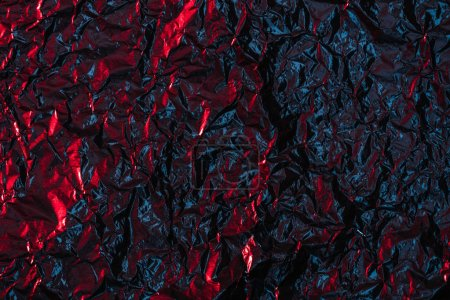 shiny abstract crumpled dark foil background