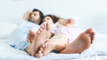 close-up view of feet of young couple sleeping together