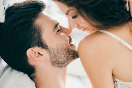 close-up view of seductive happy young couple able to kiss in foreplay