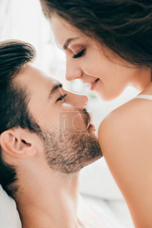 close-up view of sensual happy young couple able to kiss in foreplay