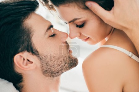 Photo for Close-up view of seductive young couple able to kiss in foreplay - Royalty Free Image