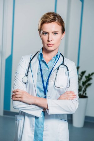 Photo for Confident female doctor with crossed arms looking at camera in hospital - Royalty Free Image