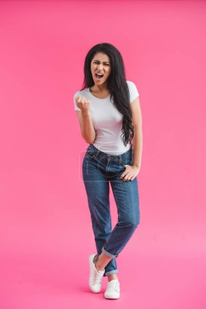 Photo for Young angry african american woman showing fist on pink backdrop - Royalty Free Image