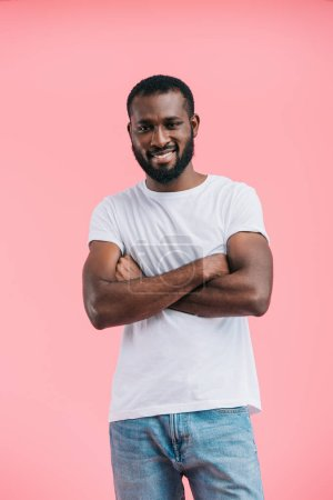 portrait of smiling young african american man in casual clothing isolated on pink