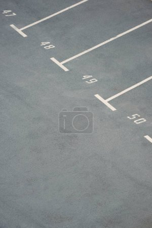 empty parking lots with numbers on grey asphalt