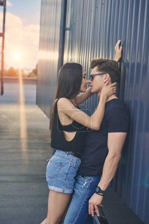 beautiful hot multicultural couple flirting and going to kiss, back light