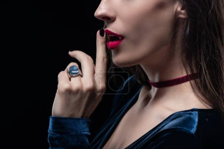 cropped view of vampire showing silence symbol isolated on black
