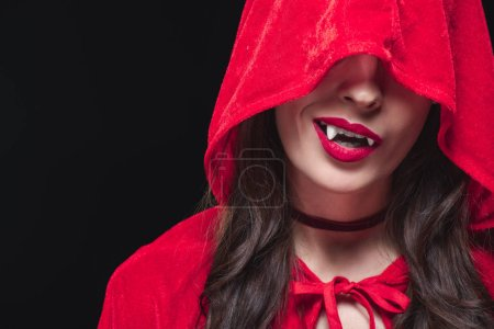 Photo for Vampire woman in red cloak isolated on black - Royalty Free Image