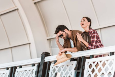 upset man and praying woman watching horse races at ranch stadium