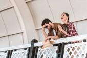upset man and praying woman watching horse races at ranch stadium