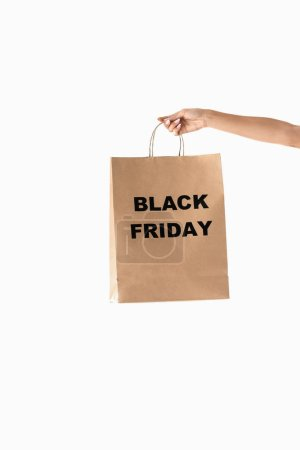 partial view of hand with shopping bag for black friday, isolated on white