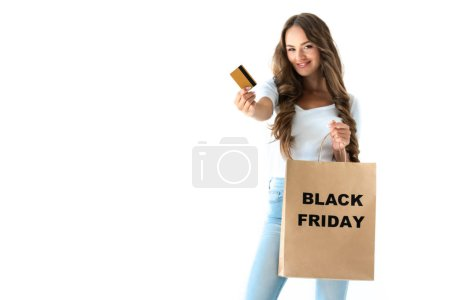 happy girl holding golden credit card and shopping bag with black friday sign, isolated on white
