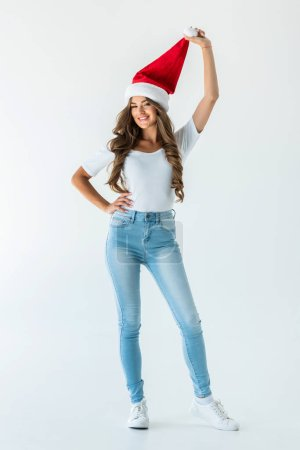 cheerful stylish girl posing in santa hat, isolated on white