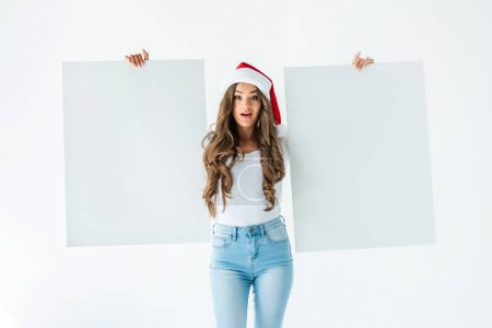 excited girl in santa hat holding blank cards, isolated on white