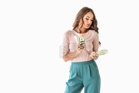 beautiful young woman counting dollar banknotes, isolated on white