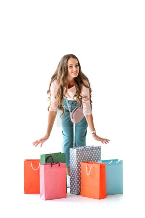 Photo for Beautiful happy woman posing with shopping bags, isolated on white - Royalty Free Image