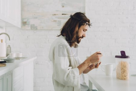 side view of Jesus eating corn flakes on breakfast in kitchen at home