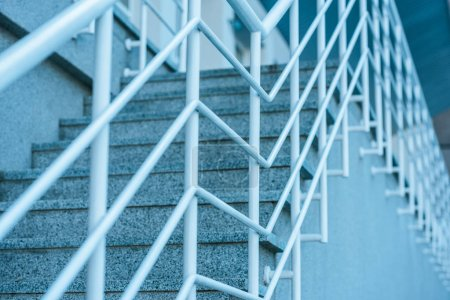 Photo for Low angle view of grey stairs with white railings - Royalty Free Image