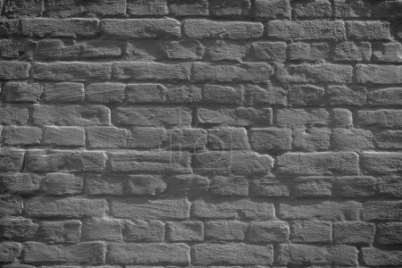grey grunge weathered brick wall background, full frame view