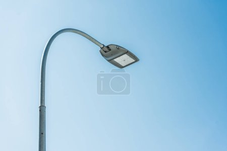 low angle view of street lamp against blue sky